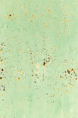 abstract background of rusty metal painted green