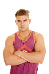 man purple tank top arms folded serious close