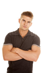 man short sleeve gray shirt arms folded serious