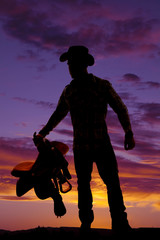 silhouette man cowboy saddle wear hat