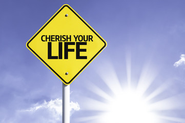 Cherish your Life road sign with sun background
