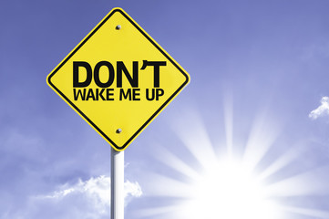 Don't Wake me Up road sign with sun background