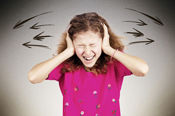 Stressed teen girl screaming, shouting covering ears with hands