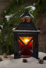 Candle burning brightly in Lantern during the holidays