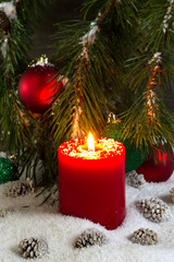 Burning red Candle during the holidays