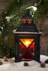 Metal Lantern with Glowing Candle during the holiday season