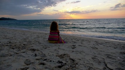 Sad Woman at the Beach against Sunset. Loneliness and Solitude