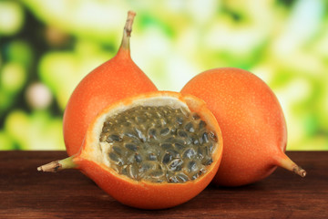 Passion fruits on table on bright background