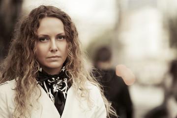 Portrait of beautiful fashion woman on the city street