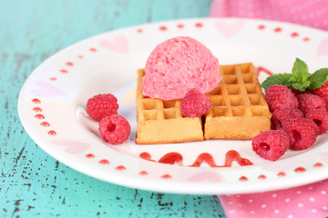 Tasty belgian waffles with ice cream on wooden table
