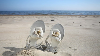 Female flip-flops on the beach. Full HD with motorized slider. 1