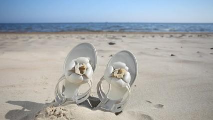 Female flip-flops on the beach. Full HD with motorized slider. 1