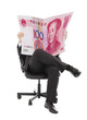 Business people sitting on a chair with china currency
