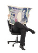Business man sitting on a chair with japan currency