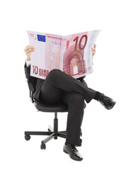 Business man sitting on a chair with euro currency