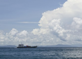 Ship transport under the blue sky and cloud