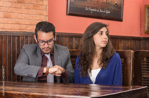 young couple in a restaurant - 67689677