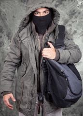 unrecognizable man wearing black hoodie over grey blackground