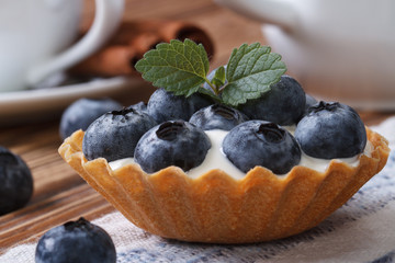 Tartlets with blueberries and cream closeup horizontal