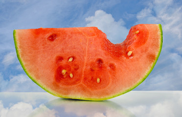 juicy watermelon with sky reflection