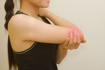 Sports injury ,young woman having pain in her elbow