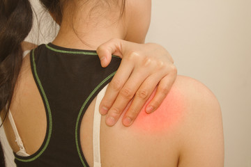 Sports injury ,young woman having pain in her shoulder