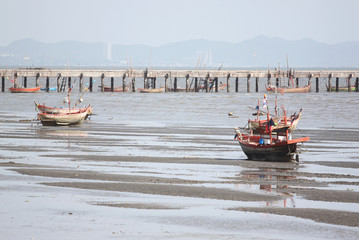 Small fishing boats on the Seashore.