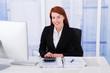 Confident Businesswoman Calculating Tax