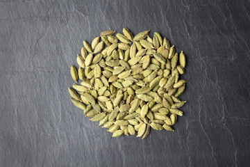 Cardamom seeds on a slate plate close up
