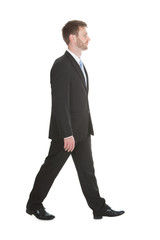 Confident Businessman Walking Over White Background