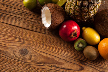Super tasty tropical fruits on wooden table