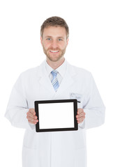 Smiling Young Male Doctor Displaying Digital Tablet