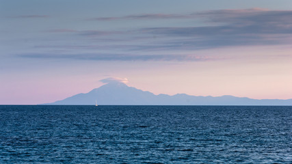 View of the holy Athos mountain from Thassos island at sunset