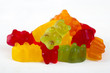 colorful jelly bears on light wooden background - 67698080