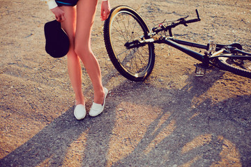Women feet alongside a bicycle