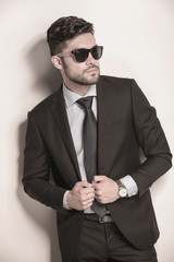 sexy business man with sunglasses holding his suit