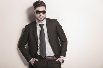 serious and cool sexy business man wearing sunglasses