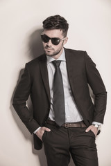 fashion model in suit and tie looking cool