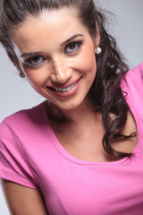 young casual woman's face smiling in studio