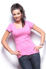 smiling casual woman standing with hands on hips
