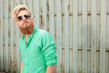 bearded man with sunglasses looking up