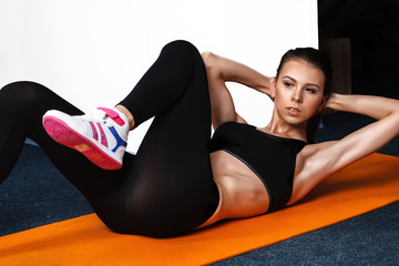 beautiful sporty woman woman doing exercises, pumping a press