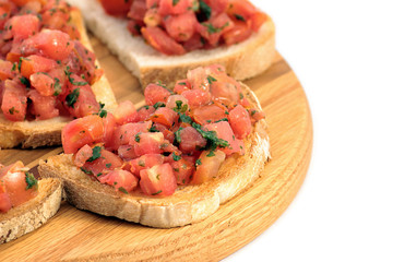 Italian bruschetta on a wooden cutting board