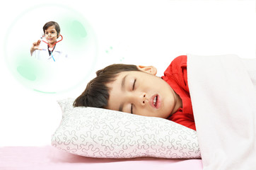 Little boy dreaming be a doctor