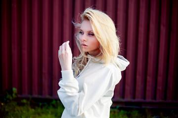 Blonde cute girl fashion look.