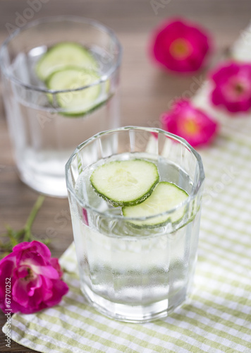 canvas print picture Cold mineral water with cucumber