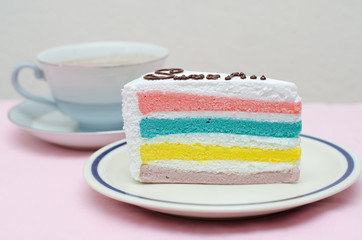 Rainbow cake with coffee