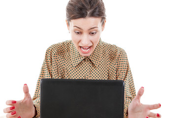 shocked young woman sitting and using laptop