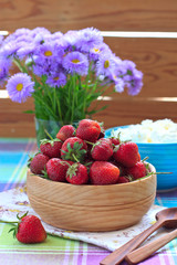 Strawberries in the wooden bowl and cottage cheese