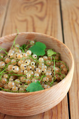 White currants in the wooden bowl